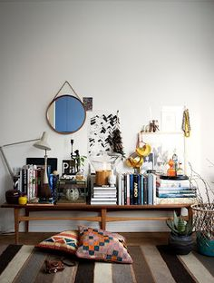bench styling, books, round mirror, striped rug, kilim pillows, boho chic