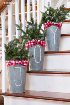Inspiring Farmhouse Christmas Decor - checkered bows and galvanized buckets. #farmhousedecor #christmas #homedecor #farmhouse #christmasfarmhousedecor #christmascraft #galvanizedmetal #farmhousebucket