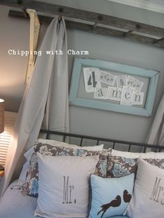 Love the ladder over head with curtains .. and the frame over bed!