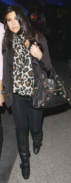 Which designer made Kourtney Kardashian's black and gold purse? Purse – Balenciaga
