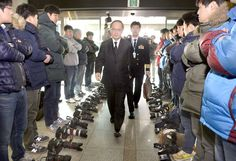 S. Korea, Japan sign pact on military intelligence sharing IN SECRET; Photojournalists Lay Down Their DSLRs In Protest (this photo was made by defense ministry officials).
