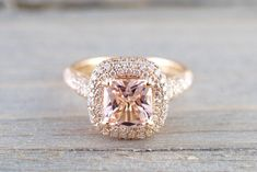 This beautiful rose gold light pink/ peach Morganite ring is simply gorgeous. The cushion Morganite is surrounded by a total of carat of diamonds that are G/VS stones. The light color of the peach complements the rose gold perfectly. Double Halo Engagement Ring, Engagement Ring Buying Guide, Morganite Engagement, Morganite Ring, Rose Gold Engagement Ring, Pretty Rings, Blue Nile, 18k Rose Gold, The Ordinary