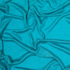 Luminescent to say the least, this spectacular jersey fabric is definitely one you do not want to pass over. Made from rayon and spandex, this material contains a phenomenal one-way stretch, a fabulously rich sheen, a silky smooth surface, and an immensely soft hand. Light-weight, semi-sheer, and with a wonderfully effortless drape, use this rayon fabric to create gorgeous draped dresses and luxurious, billowy tops. Fallen in love yet? If so, check out the 46 other magnificent colors it…