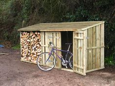 Timber log stores adapted to be used for bicycle storage. These wooden bike stores can also be used as a firewood log store! Log Shed, Bike Shed, Cool Sheds, Small Sheds, Diy Shed Plans, Storage Shed Plans, Backyard Sheds, Outdoor Sheds, Shed With Log Store