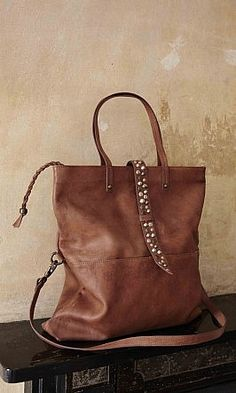 Albion Tote, mid-brown leather tote with studded leather strap closure.