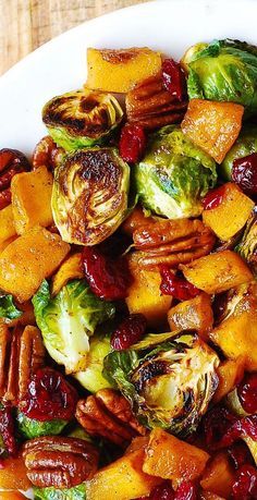 Thanksgiving Salad: Butternut Squash Brussels sprouts Cranberries Pecans The post Thanksgiving Salad: Butternut Squash Brussels sprouts Cranberries Pecans appeared first on Tasty Recipes. Side Dish Recipes, Veggie Recipes, Vegetarian Recipes, Cooking Recipes, Healthy Recipes, Delicious Recipes, Salad Recipes, Roasted Vegetable Recipes, Tasty