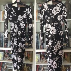 """NWOT black & white floral body con dress Sz M NWOT Bought this on Posh Retail - never worn. Really beautiful. Top partially lines. Pull on with stretch. 45"""" Shoulder to Hem. Perfect Cocktail Party or date night dress! Listed less than I paid - trying to just get some $ back Dresses Midi"""