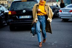 PFW Spring-Summer 2017 street style: Woman wearing Vetements coat, jeans and shoes and Loewe bag before the Loewe fashion show in Paris