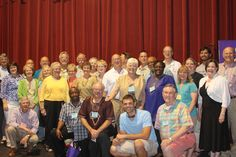 A group of Holston Annual Conference members gather on stage for a photo after an Imagine No Malaria themed worship service