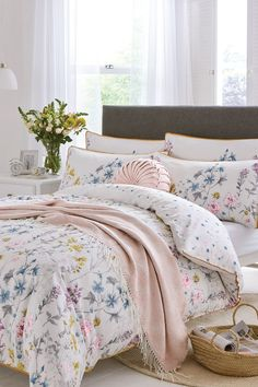 Show Less Bring a breath of fresh air to your bedroom with this 200 thread count pure cotton Laura Ashley Wild Meadow Duvet. Scattered blossoms illustrated in graceful watercolour cover the outer side, and the shades of blue, yellow, and pink, give you a range of colour options to coordinate with. The reverse side features miniatures of the print so that the pretty theme continues when the covers are pulled back. Choose from our single, double, king, or super king sizes.