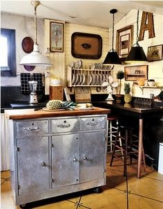 Definitely different! Quaint, I like it! 'rustic kitchen with industrial elements'