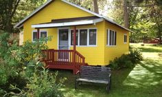 Vintage cabins and mobile homes just off the lake, where guests swim and paddle rowboats; rentals have kitchens and outdoor barbecues