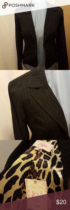 Pinstripe sparkle fitted jacket A size medium black with sparkle pinstripes fitted jacket. It is made by Candies. Has a leopard material inside and faux pockets on the front. Matching pants in a size 9 in separate listing. Bundle for a good deal on the pair! Candie's Jackets & Coats