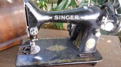 Singer 66, probably from 1938 (serial number unclear). With motor and case. Missing feed cover plate.