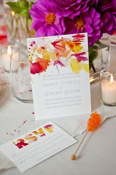 LOVE the drench of color at the top portion of these wedding invitations. Orange yellow red and purple