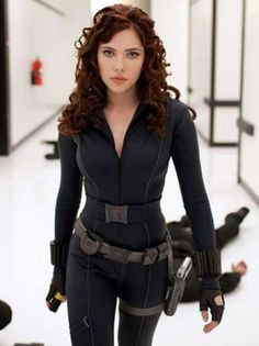 Scarlett Johansson as Black Widow: The sexy Scarlett Johansson plays Natalie Rushman and superhero Iron Man Tony Stark's assistant in the film Iron Man 2. Dressed in a black body suit complete with guns and bullets, we think Johansson looks awesome with those gorgeous locks!