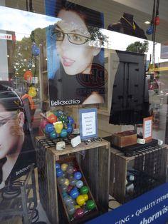 Fun use of light bulbs in Through the looking glass retail window stylists. Optometrist window display in Hawthorn Melbourne