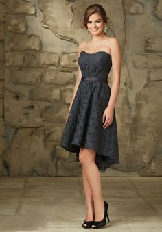 Allover lace is lovely all over, when you wear this #MoriLee #Affairs 31063 #bridesmaid dress. This high-low dress starts with a modified strapless sweetheart neckline, sloped in the center. A satin sash cinches the natural waistline. Above the knee in the front, the skirt tapers to tea length in the back, a unique twist on the classic A-line silhouette. The back fastens with a hidden zipper. Easily dressed up or down, this simple yet stylish look flatters all body types.