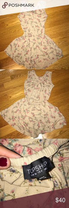 Top Shop Low Back Romper Barely worn tan with roses romper with pockets and a low back! Top Shop Dresses Backless