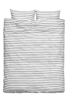 Striped duvet cover set: Duvet cover set with print stripes on fine-threaded cotton in 30s yarn with a thread count of 144. The duvet cover fastens at the bottom with concealed metal press-studs. One pillowcase.