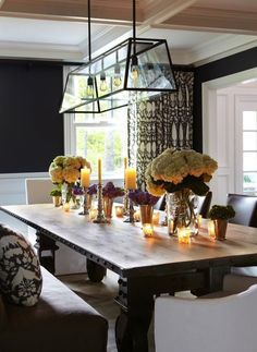 Wood Dining Table With White Hydrangea And Candle Centerpiece