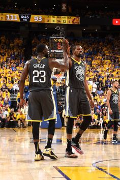f583c0c3a127 Draymond Green and Kevin Durant of the Golden State Warriors high five in  Game Two of