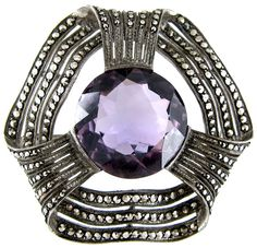 Theodor Fahrner Silver & Amethyst Brooch  Art Deco (1920-1935).   Theodor Fahrner jewellery is always well designed. It was made in Pfortzheim in the Black Forrest, Germany, and exported worlwide. It is highly collectable as it is good quality, and well documented in reference books of the period. This is a good looking amethyst, marcasite and silver brooch which is signed on the reverse.