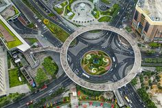 Walking In Circles: The Lujiazui Pedestrian Bridge Hovers Over Pudong Traffic