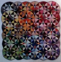 A gorgeous Winding Ways quilt by Alex Anderson.  Note the very effective placements of lights and darks as well as the way the colors flow.