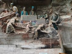 Dazu Rock Carvings. China.  Wtf is going on here?