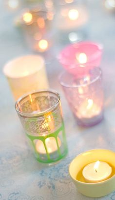 Tiny candle holders go alone way. Love these pastel shades, but would use Candle Impressions mini votives to protect them from wax and soot.