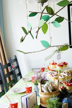woodland-pixie-party, I love the leaf Chandelier and the roll up invites!