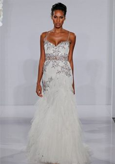 Gown features beading, embroidery, and lace.    Silhouette: Mermaid  Neckline: Sweetheart  Waist: Dropped  Gown Length: Floor  Train Style: Attached  Train Length: Chapel  Sleeve Style: Spaghetti Straps  Fabric: Lace  Embellishments: Beading, Embroidery  Color: White or Silver  Size: 2 - 28  Price: $$$$$