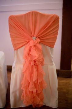Coral ruffle chair hood. By Ellis Events - Creative Chair Cover Hire and Venue Styling.