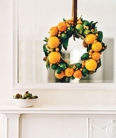 Citrus  Combine the jewels of the citrus family—kumquats, clementines, oranges, and limes—to make a pretty, sweet-smelling wreath. Start with a circular piece of florist's foam, then use wooden florist's picks to secure large items, such as oranges, first. Continue with smaller fruits. Tie with a thick velvet ribbon. The wreath should look good enough to eat for at least a week.