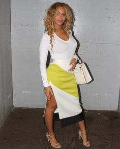 Beyoncé eases her style into fall with a long-sleeved V-neck top, high-waisted graphic skirt, and nude sandals on September 8, 2015.