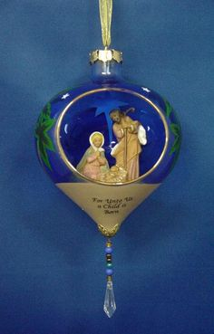 Fontanini open glass ornament from http://www.christmas-treasures.com/Fontanini/GlitterdomesandGiftware/Fontanini-Holy-Family-Ornament-54619.htm