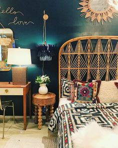 Dreamy rattan head board in magical bedroom - love the dark paint choice too