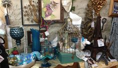 Teal Aqua tones in  Glass and Pottery , also a old 60's bill box . Gold under tones Booth display