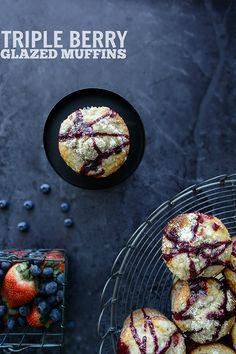 Bakery-style muffins packed with raspberries and strawberries, topped with a sugary crumb topping, and drizzled in blueberry glaze. | Kailley's Kitchen