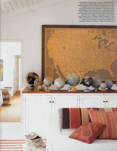 I am so drawn to maps and globes.  I don't imagine having a collection this big, but I do need to frame a map one day.    Mad Woman's To Do List: For A Mad Home: Whimsical, Eclectic, Vintage