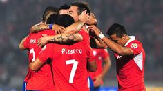 Chilean Esteban Paredes (C) celebrates with teammates after scoring against Bolivia during their FIFA World Cup Brazil 2014 South American qualifying football match at Nacional stadium in Santiago on June 11, 2013. AFP PHOTO/CLAUDIO SANTANA