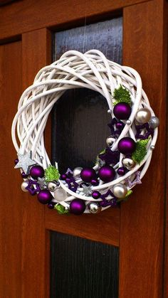The Chic Technique: White grapevine wreath with purple and silver Christmas ornaments.Trendy letošních Vánoc: Vyhrajete to s bílou, zelenou a fialovou - galerieStunning Useful Tips: Wicker Decoration Chandeliers wicker stool side tables. Wreath Crafts, Diy Wreath, Holiday Crafts, White Wreath, Purple Wreath, Ornament Wreath, Grapevine Wreath, Purple Christmas, Noel Christmas