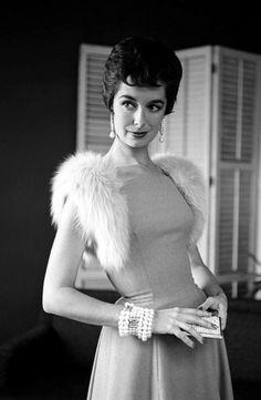 1957 Fox shoulder straps dyed to match gray flannel dress by Anne Fogarty, photo Nina Leen