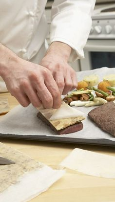 ROLLING OUT. A crust rolled out between two sheets of SAGA paper, chilled and cut to form gives the final touch to the steak. Butcher Block Cutting Board, Saga, Rolls, Touch, Baking, Paper, Patisserie, Buns, Bakken
