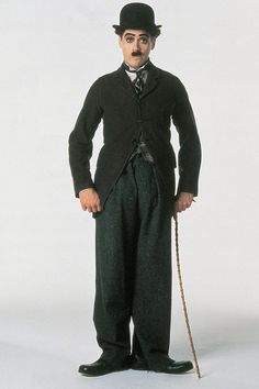 Robert Downey Jr. as Charlie Chaplin in Chaplin | 23 Incredible Photos Of Actors Vs. The Historical Figures They Played