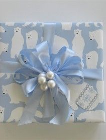 Love this Christmas gift wrap design—blue & white polar bear gift wrap paper❣ | Carolyne Roehm