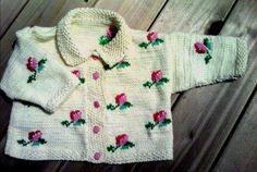 http://www.ravelry.com/patterns/library/rosebud-cardigan-set