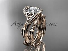 Purchase white gold celtic trinity knot engagement set, wedding ring with Black Diamond center stone from AnjaysDesigns on OpenSky. Celtic Engagement Rings, Unique Diamond Engagement Rings, Celtic Wedding Rings, Engagement Wedding Ring Sets, Designer Engagement Rings, Vintage Engagement Rings, Celtic Rings, Wedding Bands, Celtic Trinity Knot