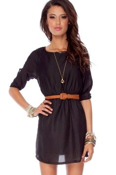 little black dress and camel colored belt.